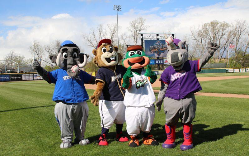 4 Mascots standing on Jimmy John's Field