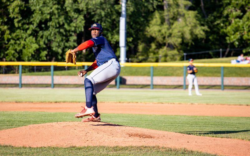 An utica unicorns baseball pitcher throwing a ball