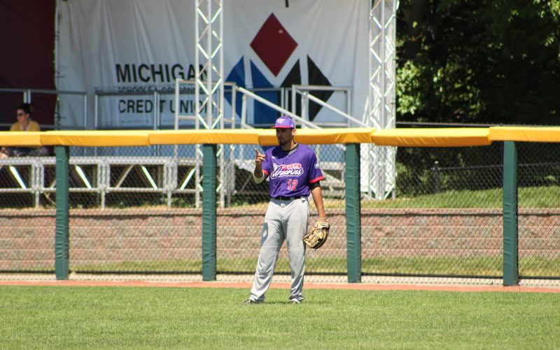 An utica unicorns baseball player pointing his finger